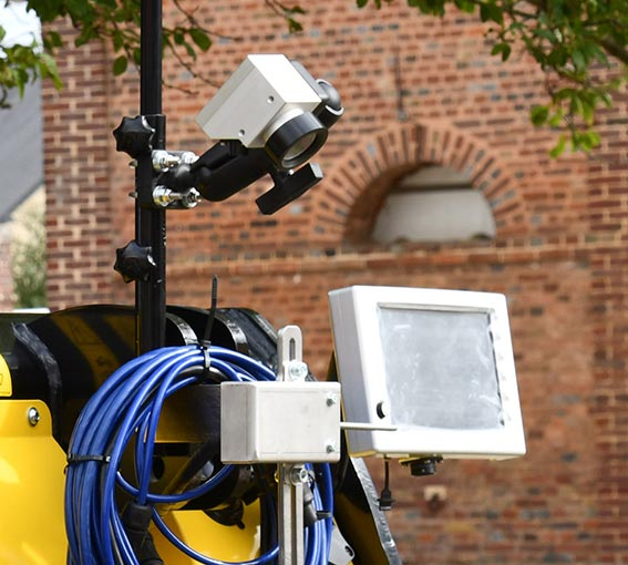 Electronics and guidance devices adapted to camera precision row hoes